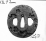 130958: Steel Tsuba sword guard of a