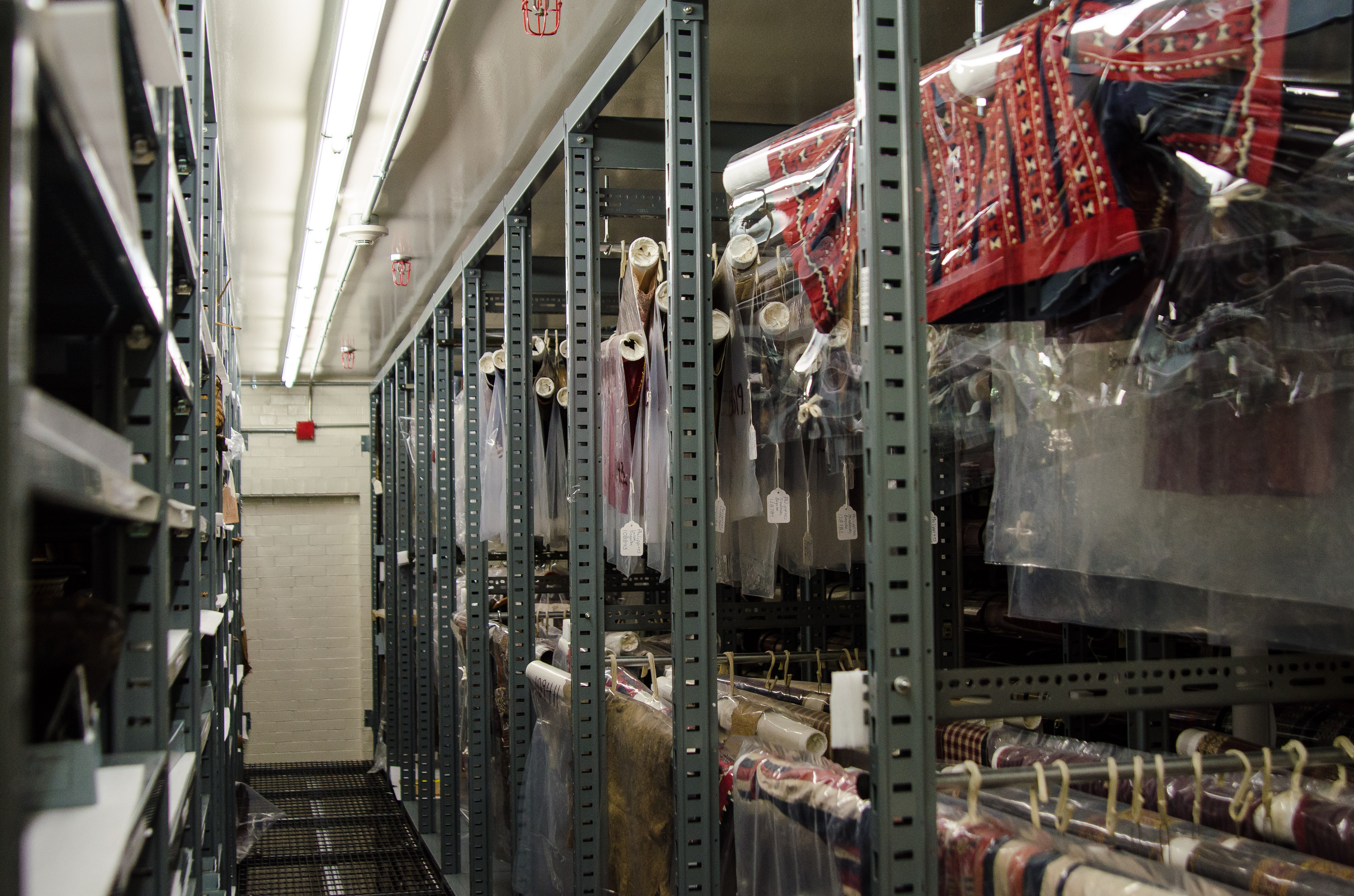 Image depicting rolled textiles at their storage designations within CAS Mezzanine storeroom. Selected for use on the homepage of the Philippine Heritage Collections interactive web portal. (c) Field Museum of Natural History - CC BY-NC