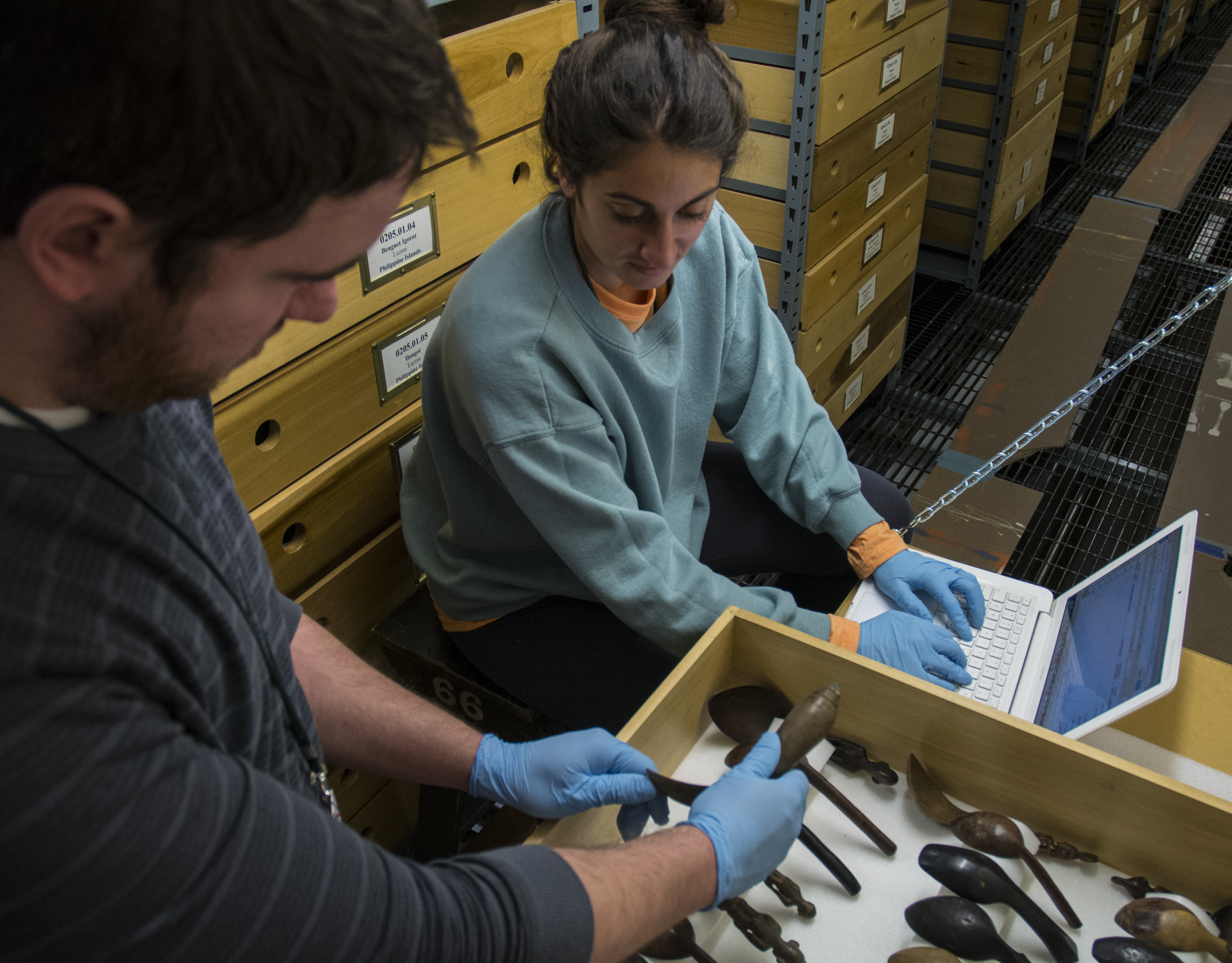 Image depicting volunteers Dustin Weddle and Bronwen Phillips inventorying objects within CAS Mezzanine storeroom. Selected for use on the homepage of the Philippine Heritage Collections interactive web portal. (c) Field Museum of Natural History - CC BY-NC