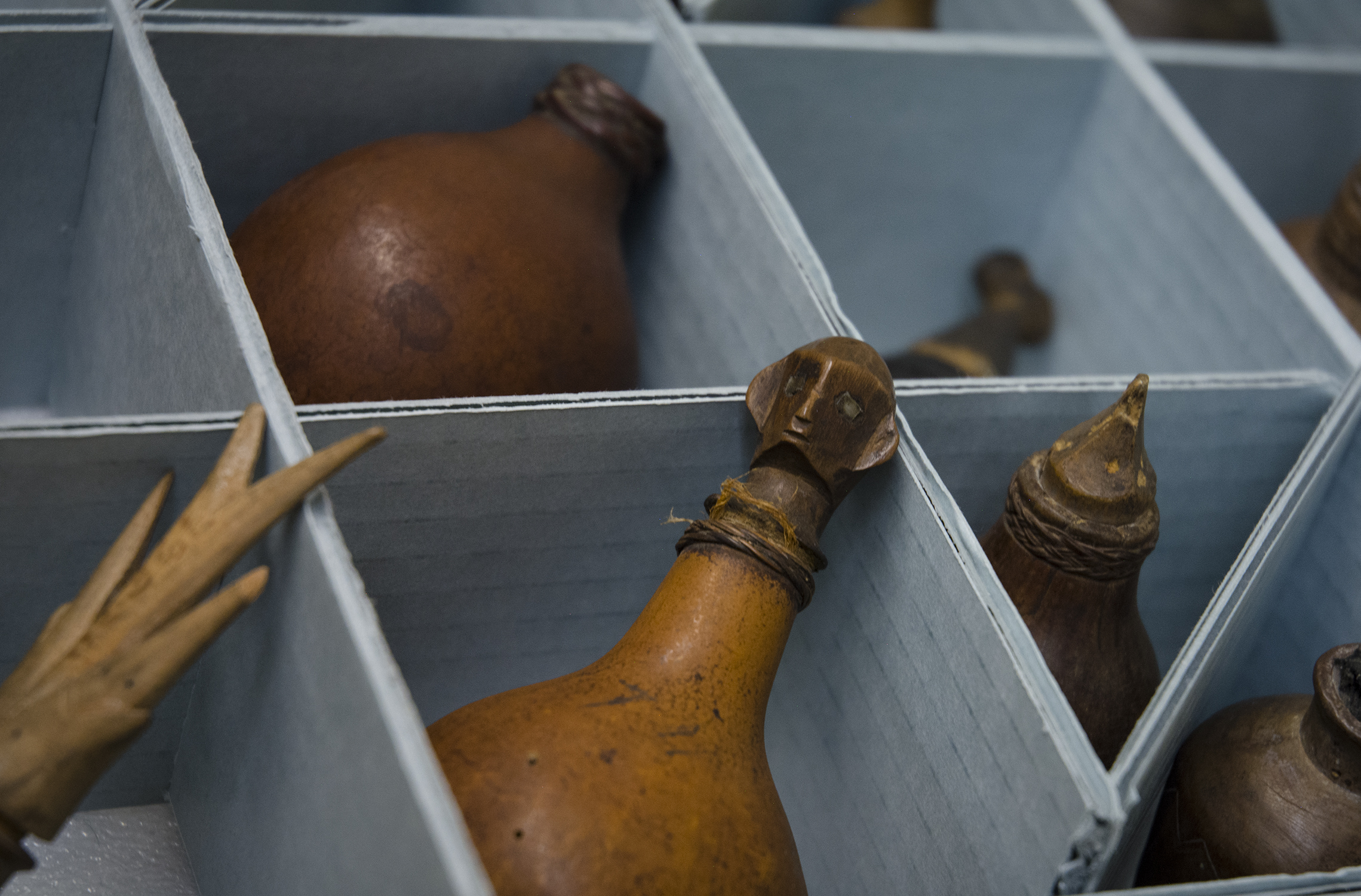 Image depicting lime holders within CAS Mezzanine storeroom. Selected for use on the homepage of the Philippine Heritage Collections interactive web portal. [Copyright] Field Museum of Natural History - CC BY-NC
