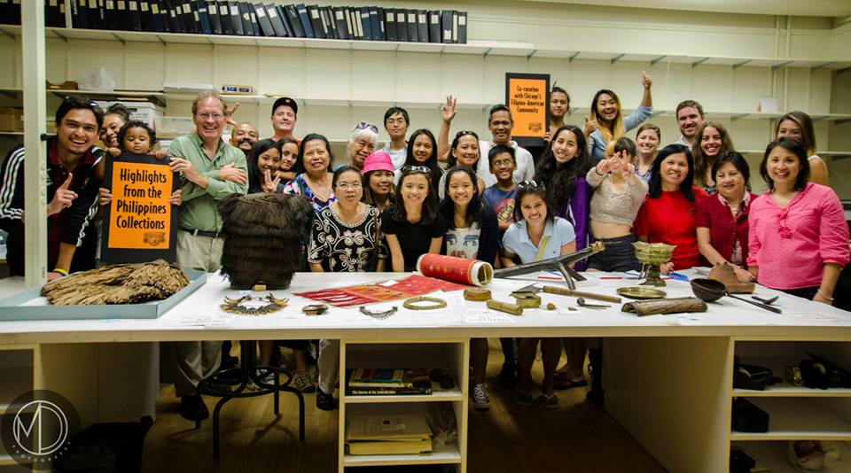 Image depicting the Young Filipino Americans of Pittsburgh (YFAP) visiting the Digital Co-Curation Team and touring the collections in CAS Mezzanine storeroom in a group picture. Selected for use on the homepage of the Philippine Heritage Collections interactive web portal.  (c) Field Museum of Natural History - CC BY-NC