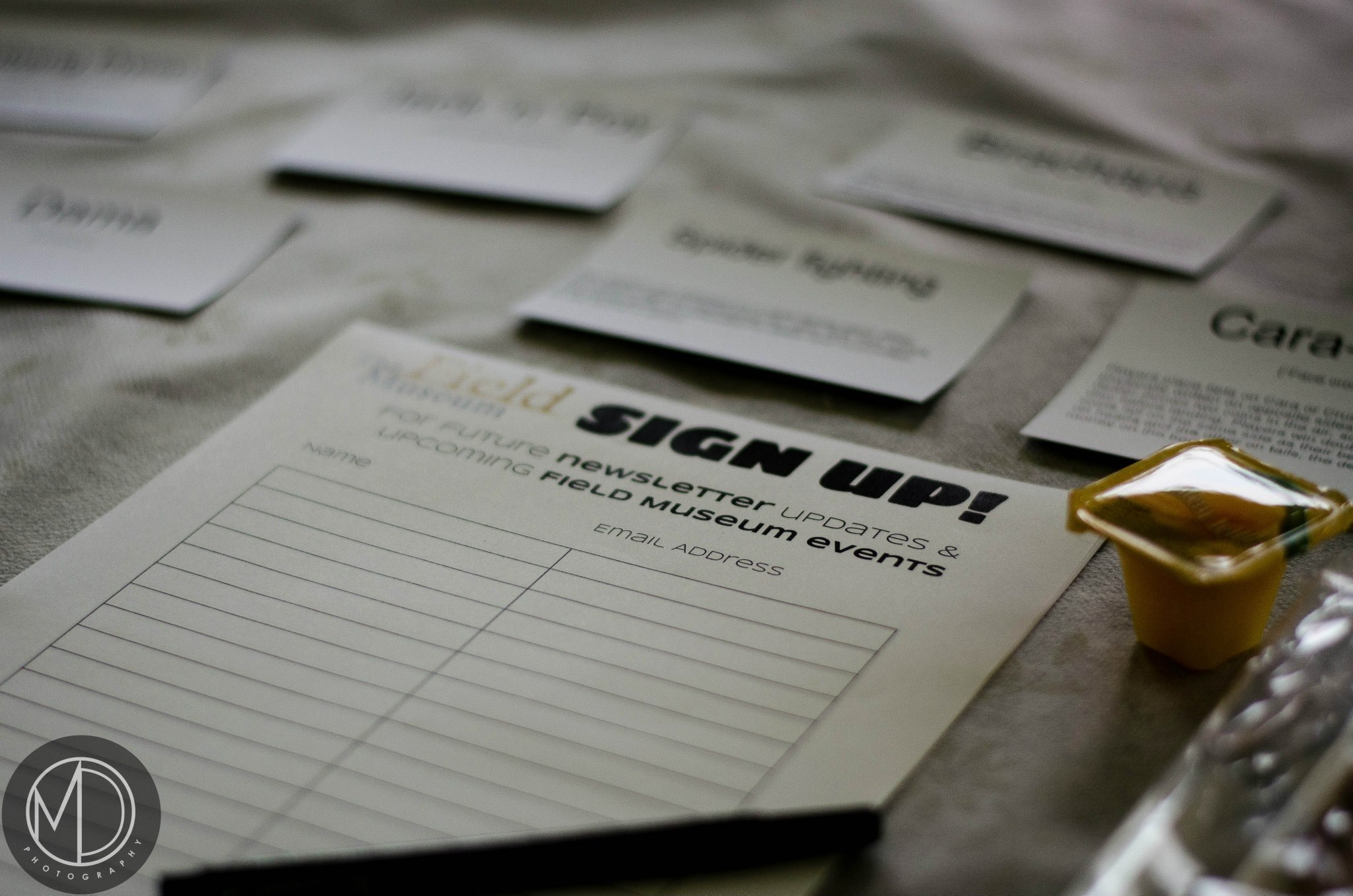 Close up of sign up sheets on The Field Museum's table in the Cultural tent.