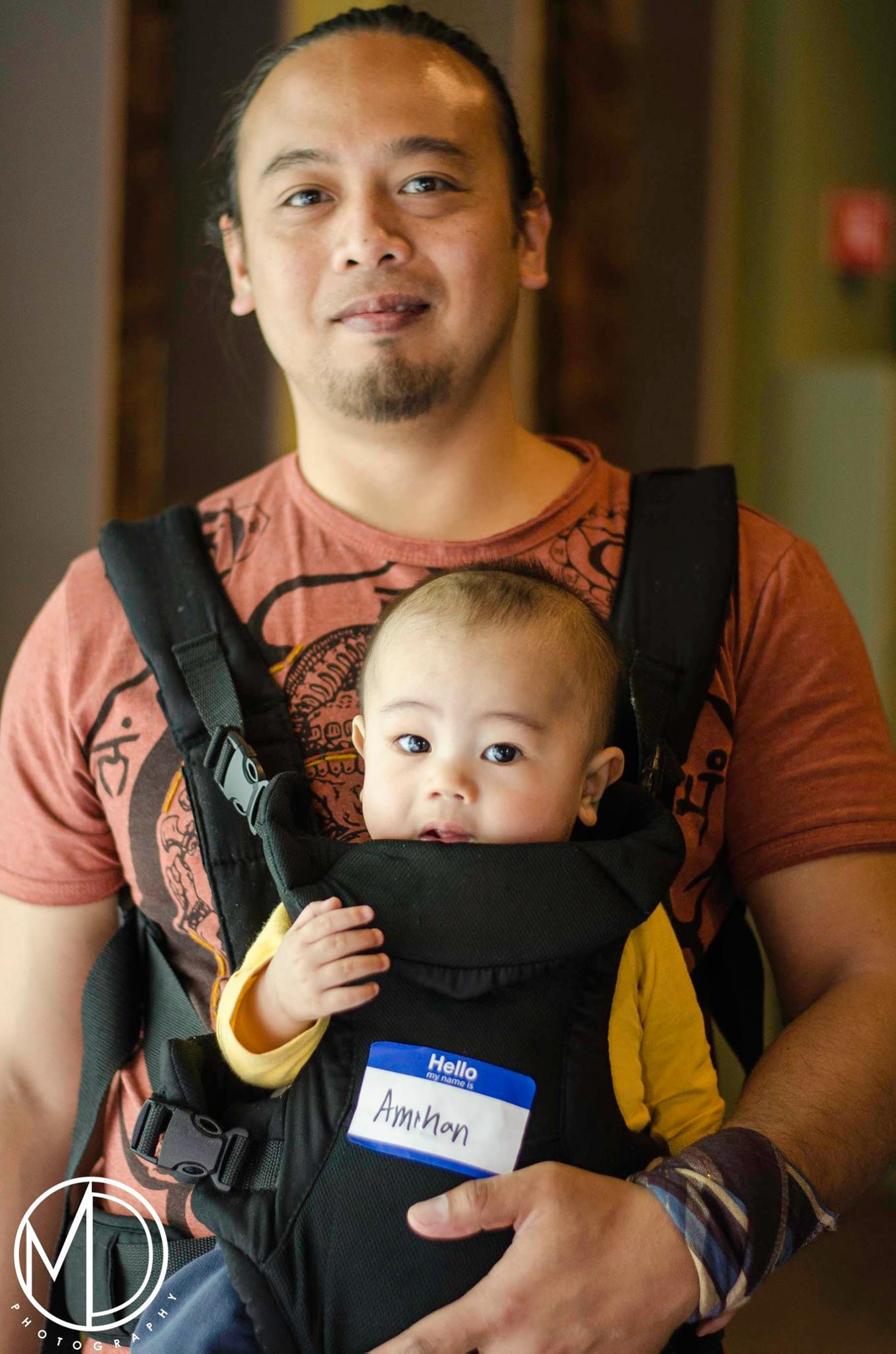 Guest holding his son.