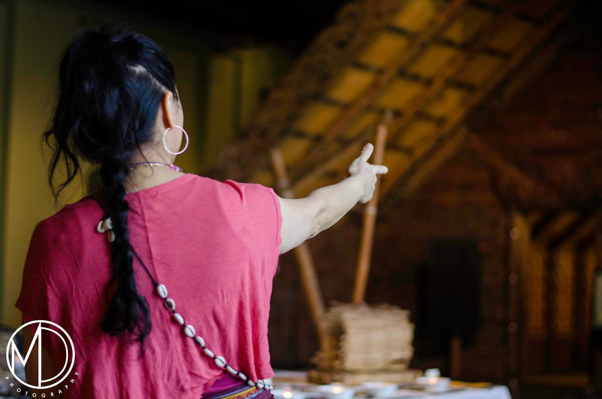 Co-host Irene Juaniza addressing the Maori House.