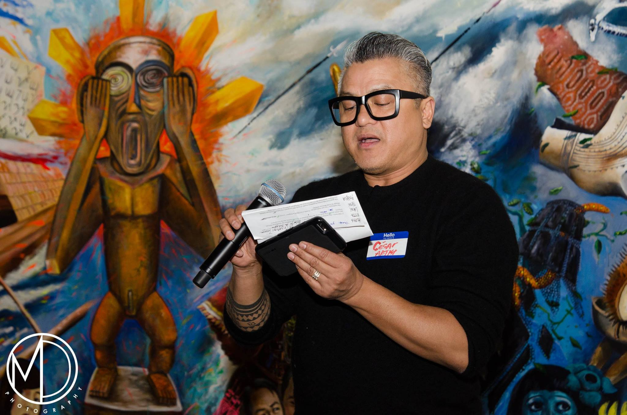 Local artist Cesar Conde presents to the audience about his contributions to the Art and Anthropology exhibit.