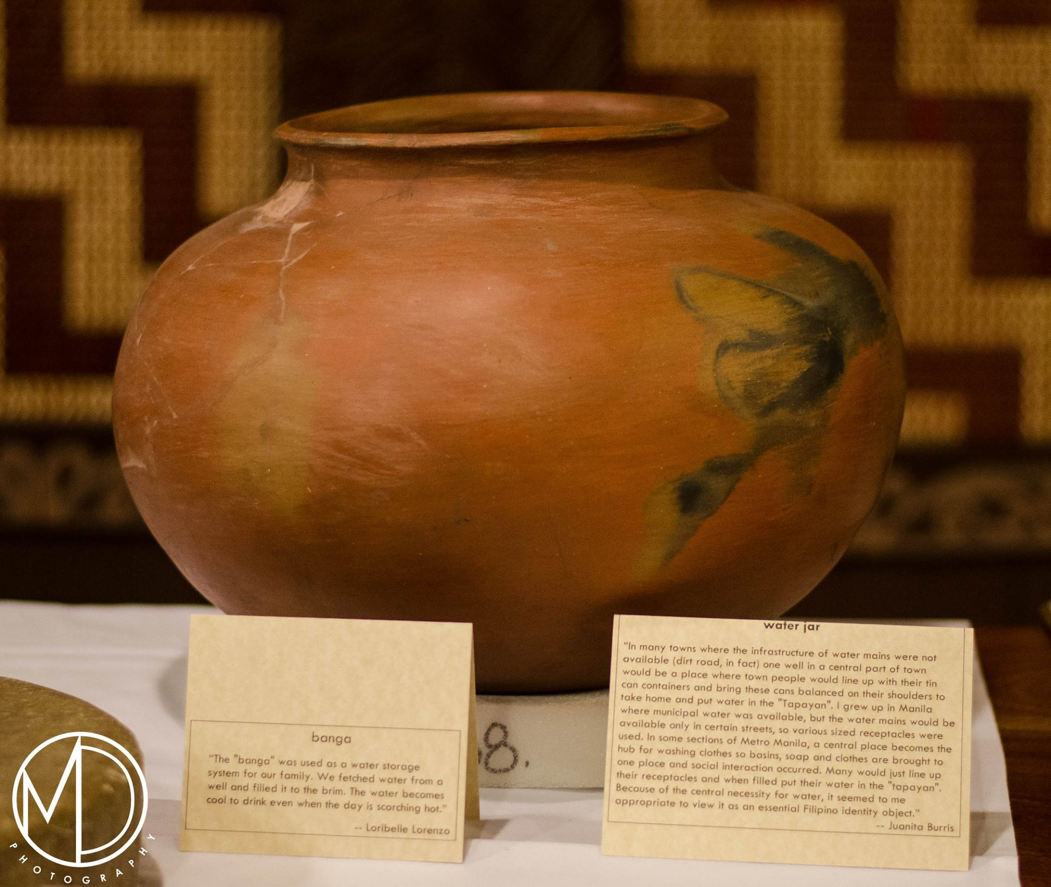 Close up image of a water jar on the artifact display tables.