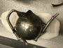 110023.A pewter wine puzzle pot in form of peach