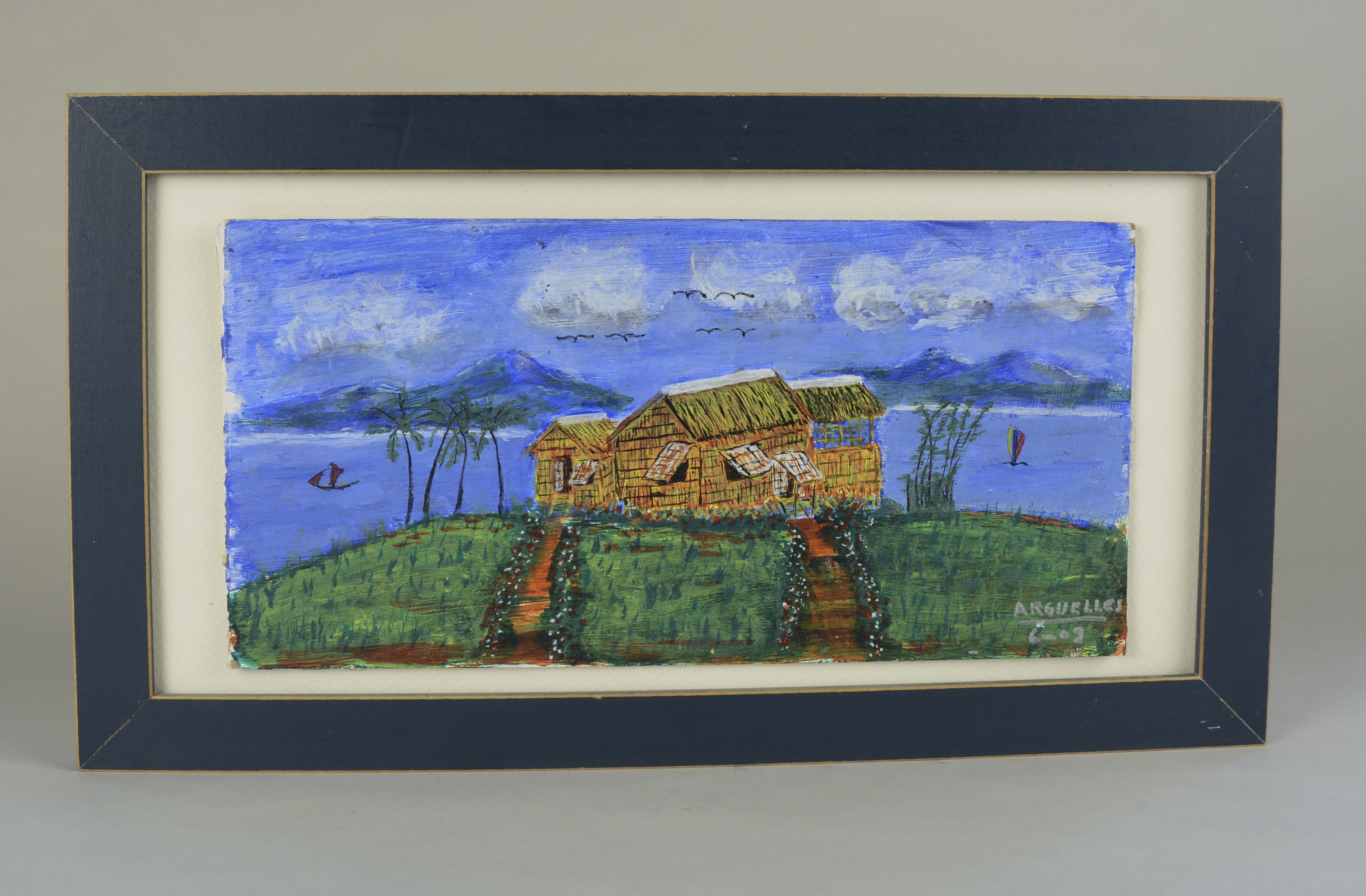 """Painting owned by Magdalena Arguelles.The painting was made in 2009 in Chicago. Arguelles said her father Jose made it from memory at the age of 78. He was not a trained artist. Arguelles' father gave her the painting as a gift. The painting depicts an island off of Iloilo called Nasidman Island, which is part of Ajuy, Iloilo. It is a private homesteaded island. The painting is signed """"Arguelles 2009"""". Arguelles said the painting is important because it is where she comes from.   Any views, findings, conclusions, or recommendations expressed in this story do not necessarily represent those of the National Endowment for the Humanities. (c) Field Museum of Natural History - CC BY-NC 4.0"""
