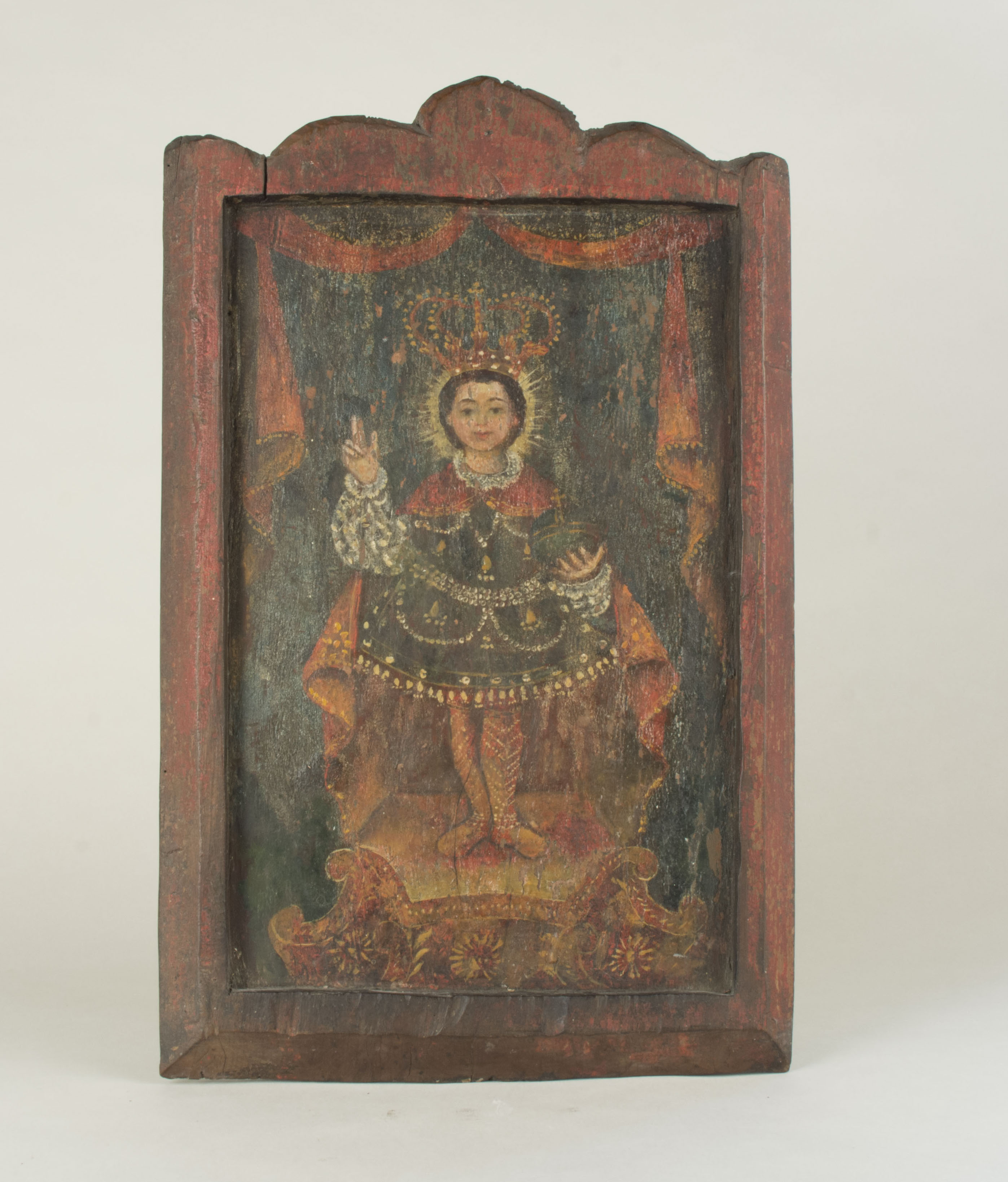 Santo Nino painting owned by Claudia Jamilla- front Possibly from the nineteenth century. This was given as a wedding gift in 1994 from Claudia's maternal uncle.. Claudia added that this was from the Visayas but was unsure whether it was from Cebu or Bohol. Santo Niño Basilica Cebu. Claudia noted that this reminds her of a significant incident that occurred on her wedding day. Her cousin (the daughter of the uncle who gave her this gift) was kidnapped on the day of Claudia's wedding, held for ransom, and released after wedding.   Any views, findings, conclusions, or recommendations expressed in this story do not necessarily represent those of the National Endowment for the Humanities. [Copyright] Field Museum of Natural History - CC BY-NC