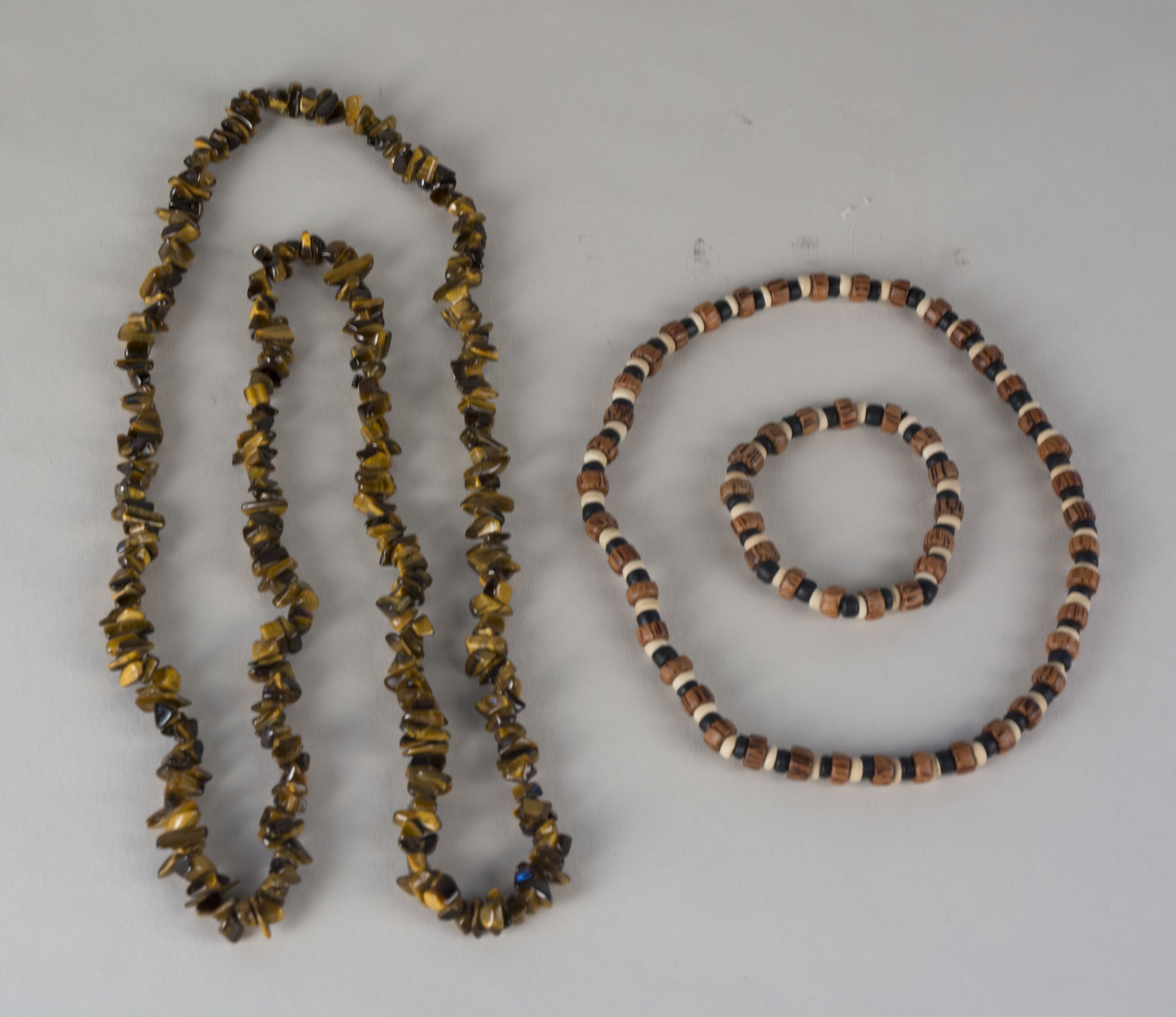 Necklaces and Bracelet owned by Necitas Tan Objects were a gift from Tan's niece, Eva Denoman, who is from Iloilo. They were given to Tan in 1975. Tan wears these to match her Filipino-style clothes, which she wears to gatherings.   Any views, findings, conclusions, or recommendations expressed in this story do not necessarily represent those of the National Endowment for the Humanities. [Copyright] Field Museum of Natural History - CC BY-NC