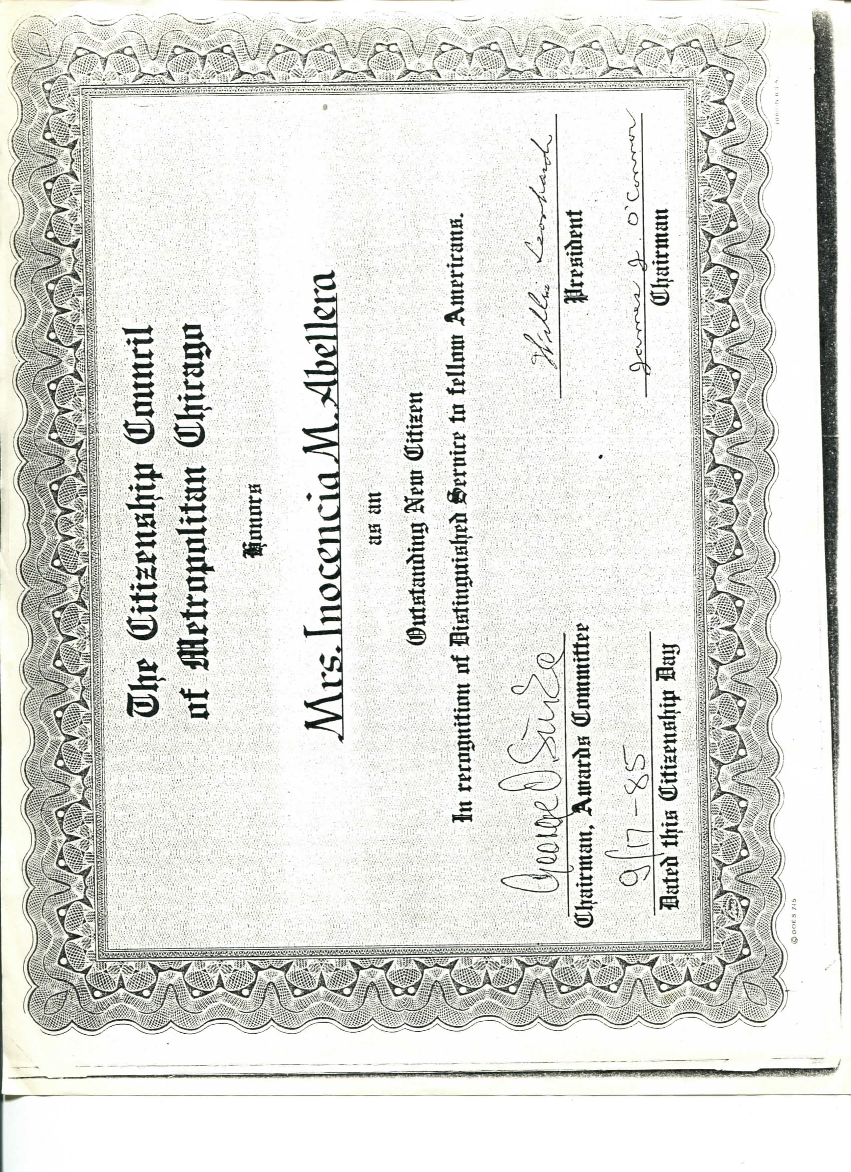 """Scanned document owned by Kirsten Surla. Certificate of """"Outstanding new citizen"""" Made Sept 17, 1985, acquired around 2017 from late grandmother's belongings. In English, honors Mrs. Inocencia M. Abellera [Surla's grandmother] as outstanding new citizen. Reminds Surla of her grandmother's civic engagement, her involvement in the community and in Chicago.   Any views, findings, conclusions, or recommendations expressed in this story do not necessarily represent those of the National Endowment for the Humanities. [Copyright] Field Museum of Natural History - CC BY-NC"""