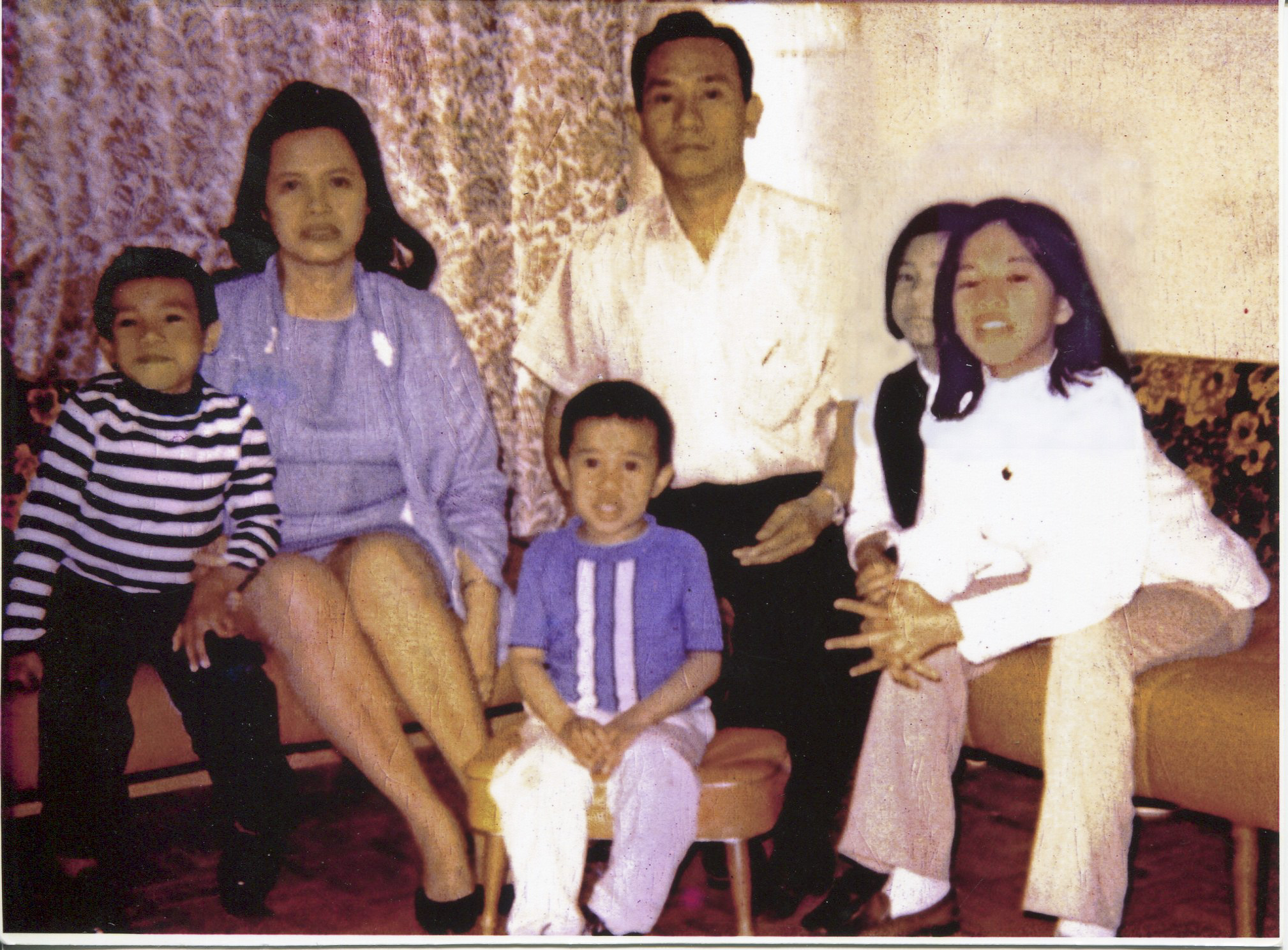 """Photo of Arguelles and family This photo is a copy but the original was taken in 1970. Arguelles acquired it in 2011 from her mother's collection of her father's things (after his death). The photo was taken in Toronto, Canada. Left to right are pictured: Lester (brother), Magdalena (mother), Gene (brother), Jose (dad), Magdalena, Althea (sister). Arguelles said the photo may have been taken at a party because the people pictured all dressed up in """"fineries"""" and food was served. Arguelles talked about her family's early years of being immigrants in Canada. The family was intact but her parents still struggled. Arguelles said the photo makes her think of her experiences and struggles in the early years in Canada. Arguelles also highlighted her sister, who wrote a poem about Canada that won an award. Her sister's poem was read over the school intercom and used an Indian word for the title, which sticks out for Arguelles. She was proud of her sister. They all struggled though they were different. Arguelles said she knows it was hard on her parents.   Any views, findings, conclusions, or recommendations expressed in this story do not necessarily represent those of the National Endowment for the Humanities. (c) Field Museum of Natural History - CC BY-NC 4.0"""