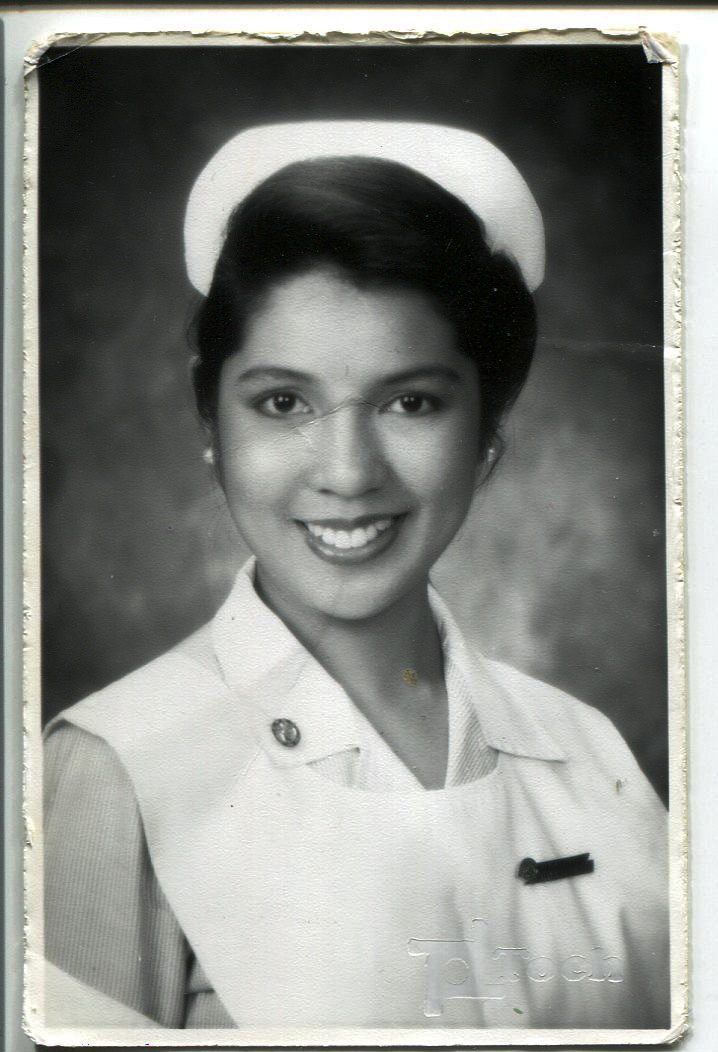 Photo of Ira Escarilla- Carnate. Taken at the end of the school year around March 1994 by a professional photographer (TOCH Photography) in Manila. This photo was required for the yearbook. Escarilla-Carnate is pictured graduating from nursing school, wearing white nursing cap. This photo belonged to Escarilla-Carnate's mother.  This is important because Escarilla-Carnate wanted to be a nurse and go to UP Manila (Phil General Hospital.) She added that it was tough to get into UP and finished it on time because only 50 students were accepted for the 1991 school year in the whole country. She is the only one from Iloilo who was accepted in her class. She remarked that her mother encouraged her to finish nursing school in Manila but her parents didn't like her being alone there. Escarilla-Carnate remarked that it made her more independent and resilient.   Any views, findings, conclusions, or recommendations expressed in this story do not necessarily represent those of the National Endowment for the Humanities. [Copyright] Field Museum of Natural History - CC BY-NC