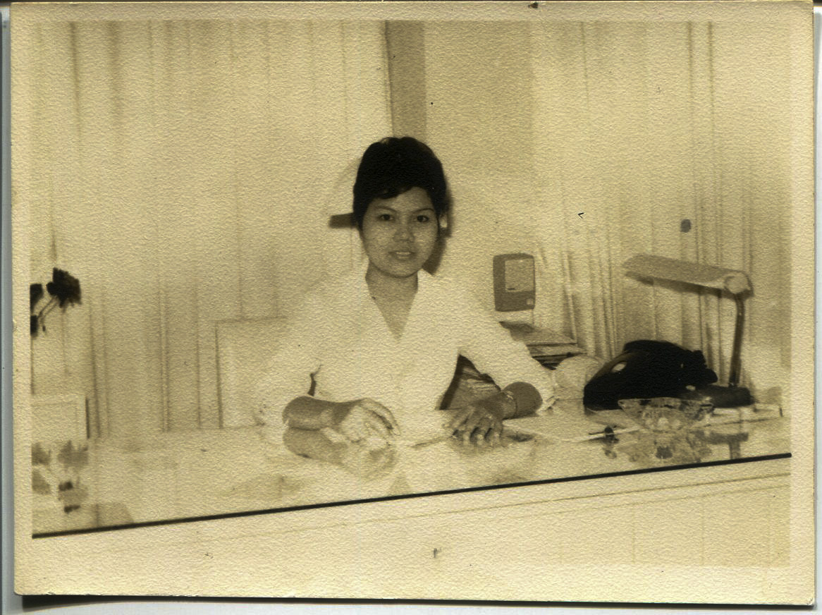 """Photo of Tan, 1965.  It is a picture of Tan, an office nurse at the Filipinas Hotel at Padre Faura. The back of the photo says """"Please return to Necitas D. Tan class of 1963"""". Tan said she was lucky to be hired as an office nurse at a hotel. Tan said there were lots of offices, with one used by a nurse from Canada. It is from that nurse that Tan heard Canada was recruiting. Tan went to Canada in 1965 then moved back to the Philippines in 1968. Tan moved to Chicago in 1969.   Any views, findings, conclusions, or recommendations expressed in this story do not necessarily represent those of the National Endowment for the Humanities. [Copyright] Field Museum of Natural History - CC BY-NC"""