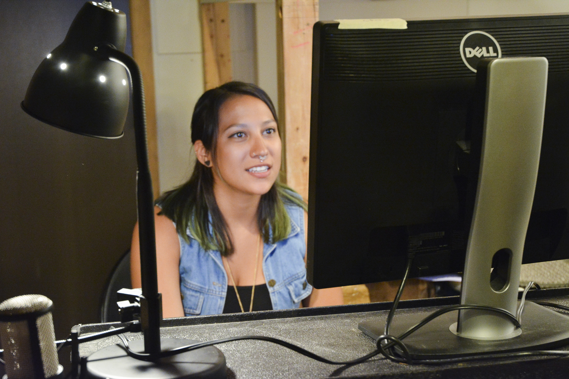 Museum volunteer Trinity Medellin working in the audio booth