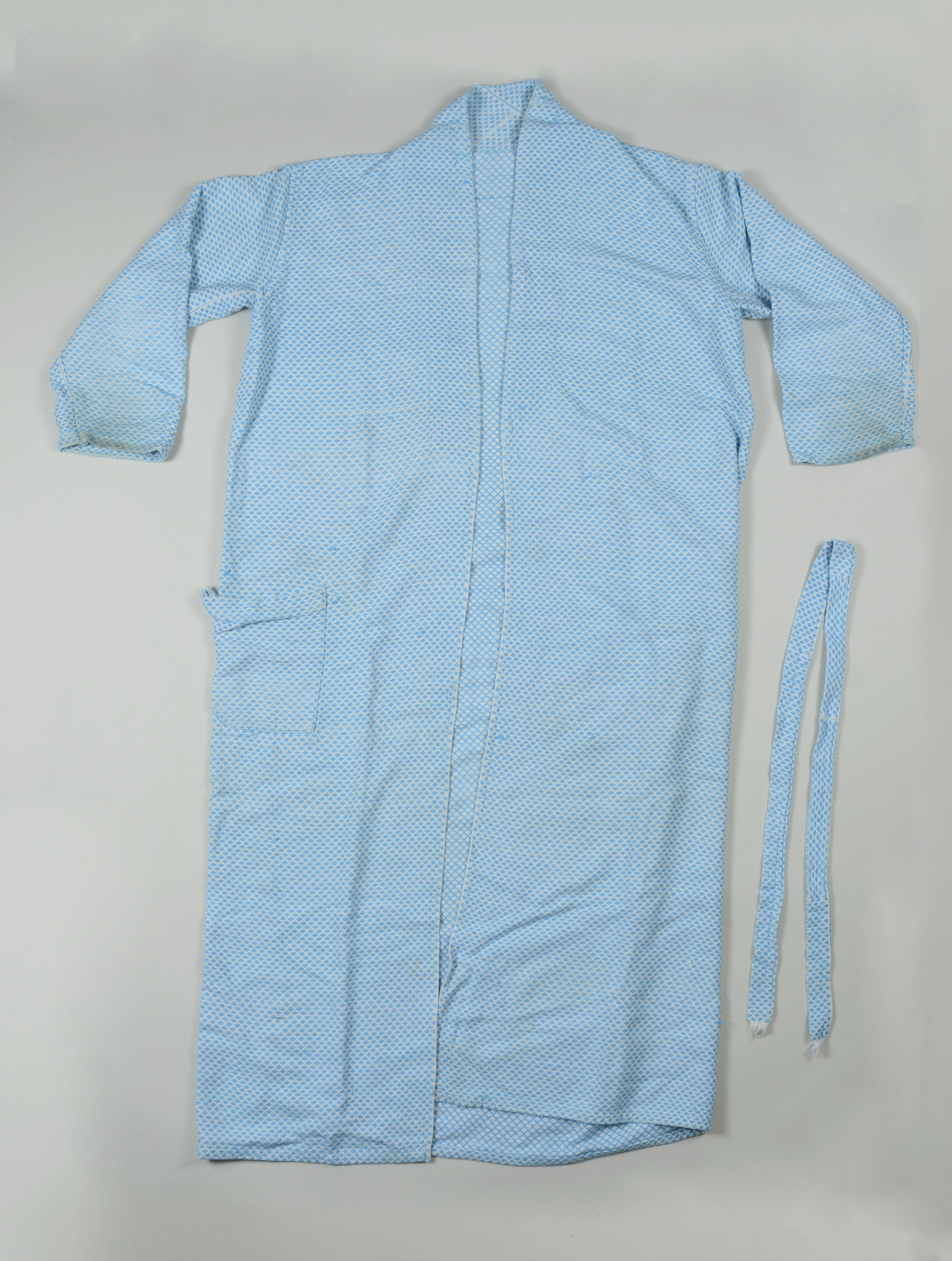 Abel Iloko (Hand woven) bath robe owned by Edwin P. Abaya- full.  Made in the 1960s and given to Edwin by his mother, who had the robe custom made for him. It was made in Vigan, Ilocos Sur. He brought it with him when he came to the US in 1968. It is important to Edwin because hand woven clothing and other products are and have been a thriving industry in Ilocos Sur and he does not know if we have any examples of this work in our collection at the Field Museum. He wants to make sure they are represented. He says the design is slightly unusual for the time, as they were usually more geometric. He does not wear it anymore because he wants to preserve it. He says he is grateful that this project (Homeland Memories) exists for the people who came to the US from the Philippines and wants to contribute these 2 objects to show what his hometown is known for.   Any views, findings, conclusions, or recommendations expressed in this story do not necessarily represent those of the National Endowment for the Humanities. [Copyright] Field Museum of Natural History - CC BY-NC