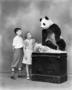 Boy and girl with panda