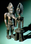 210143: Carved Wood figurine with metal