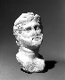 26749: Marble male bust head fragment