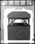 105175: Black granite sarcophagus of