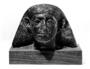 105180: Granite statue of head of man